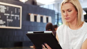 Picture of woman in the airport working on a tablet
